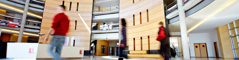 Students walking inside Vari Hall