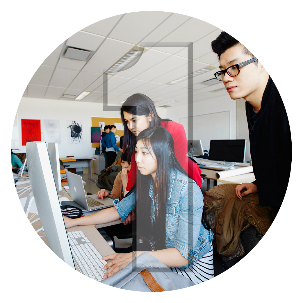 Students surrounding a computer in class