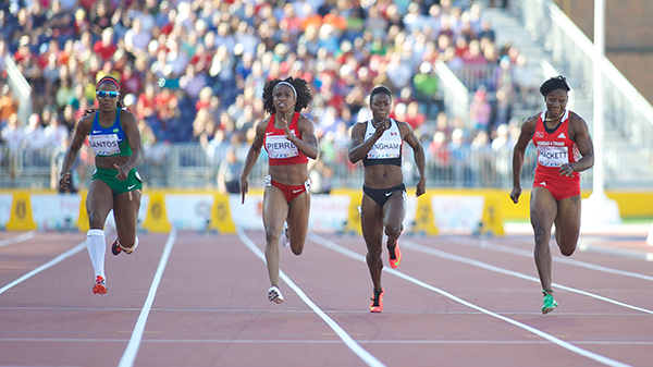 Khamica Bingham (3rd from right) runs in the 100m semifinal on July 23, 2015 at the CIBC Athletics Stadium.